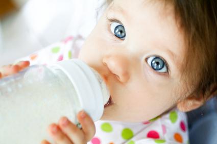 baby using bottle