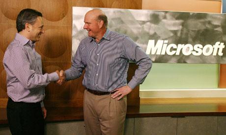 Yammer CEO David Sacks (left) and Microsoft CEO Steve Ballmer shake hands