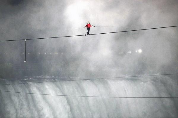 Nik Wallenda makes his historic walk on a wire across Niagara Falls.