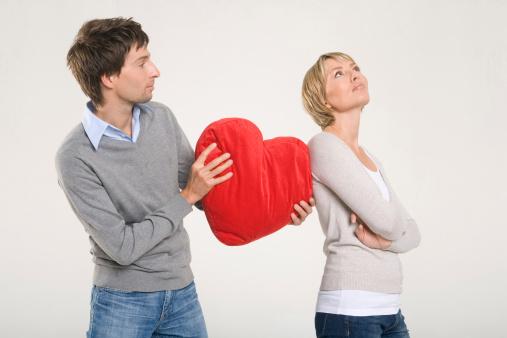 man apologising to a woman