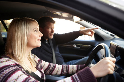 Girl driving with man