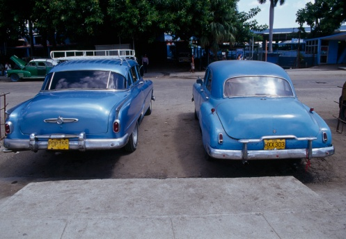 two vintage cars