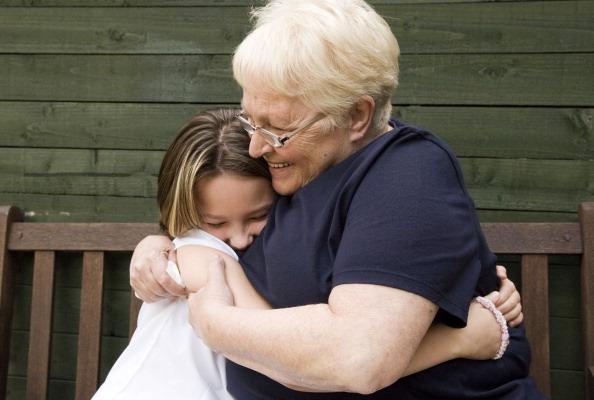 Senior woman hugging granddaughter