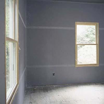 hanging drywall on a Cinderblock wall