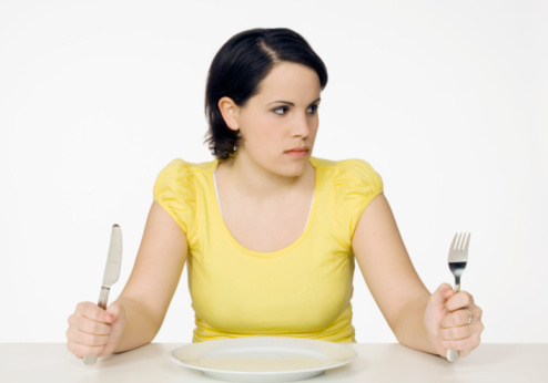 woman with a fork and spoon