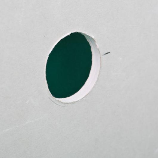 Hole in a Scrap Drywall