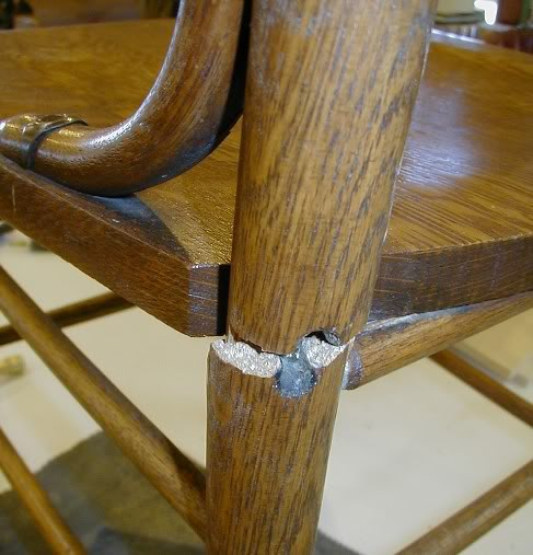 chair with broken leg 1