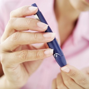Woman testing blood sugar