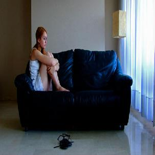 A girl sitting alone at home