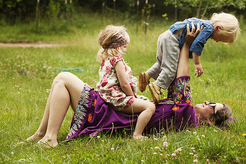 Mother playing with children
