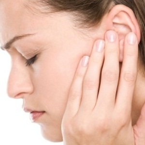 A woman suffering from ear congestion