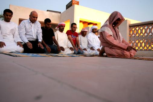 Man leading prayer