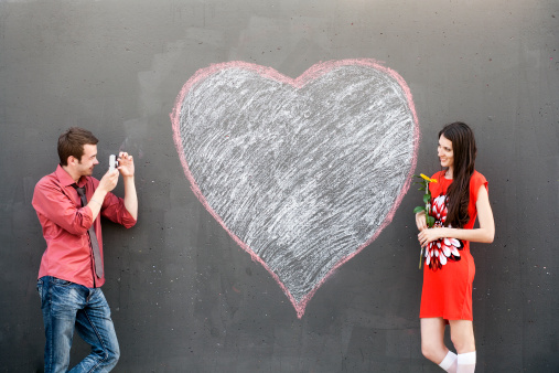 Couple posing with heart