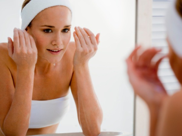 A girl washing face with cleanser