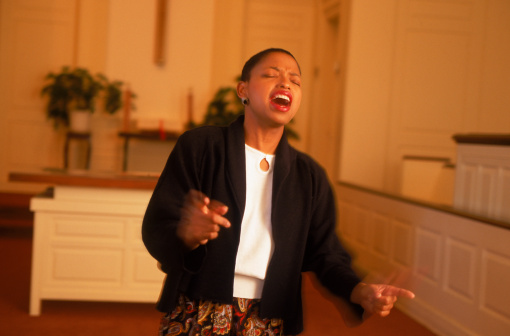 Woman gospel singer in chapel