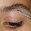 using eyebrow brush and comb