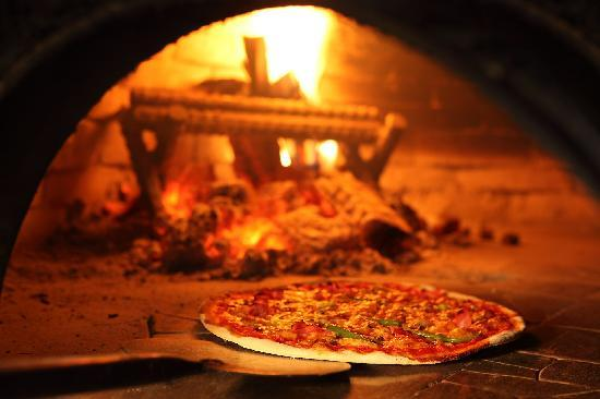 Pizza in Wooden Oven