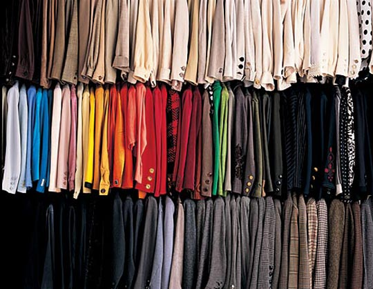 Related Articles. Organize your pile of other items in the closet by color. Move hangers on the pole or poles to leave as much room as possible between each piece. Arrange shoes on the floor of the closet, grouping casual shoes and formal shoes together. Organize sweaters and other accessories on shelving if your closet has shelves.