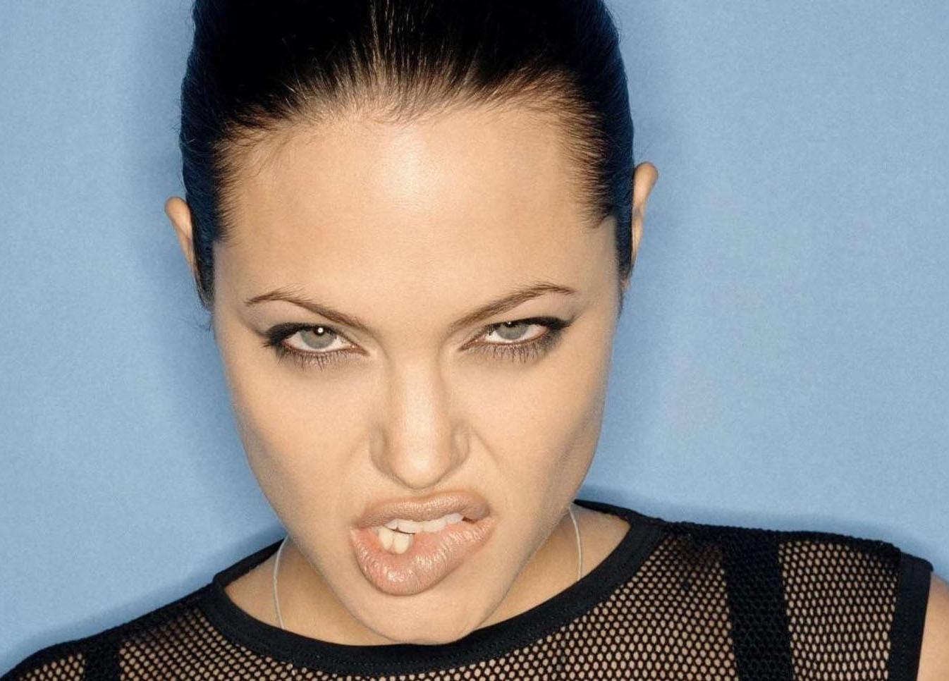 Angelina Jolie biting her lips