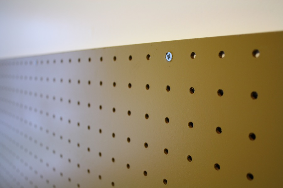 Pegboard mounted on drywall
