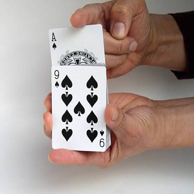 Preforming a finger trick with a deck of cards