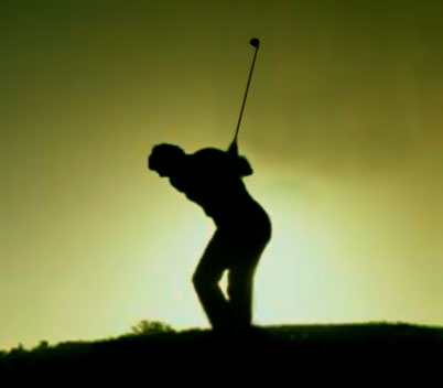 Golfer playing the shot