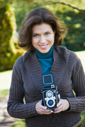 woman holding twin lens camera