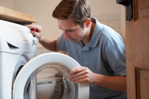 Take the Front Off of a GE Washing Machine