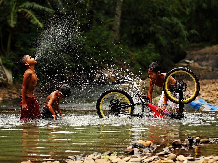 Kids washing bicycle