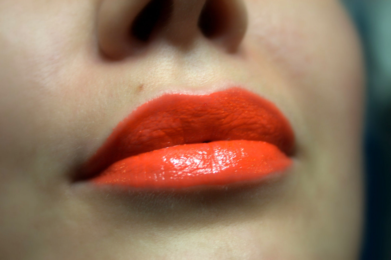 Lips with orange lipstick