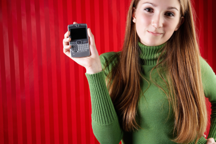 Smiling woman posing with smartphone
