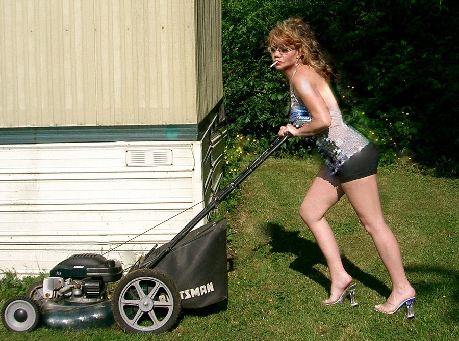 Lady using lawn mower