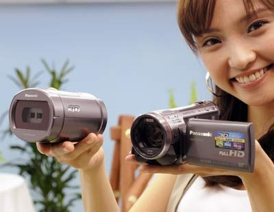 A girl with camcorder