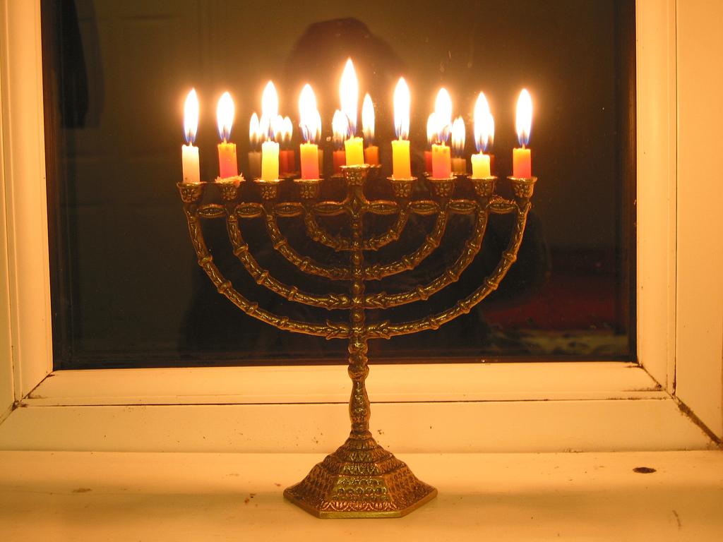 lighting an oil hanukkah menorah