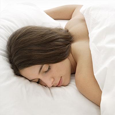 A girl sleeping on stomach