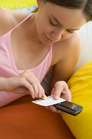 Young Woman Using Prepaid Phone Card