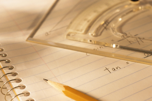 Lined notebook, pencil and protractor ruler