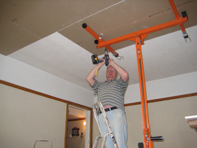 Man Building a Partition Wall