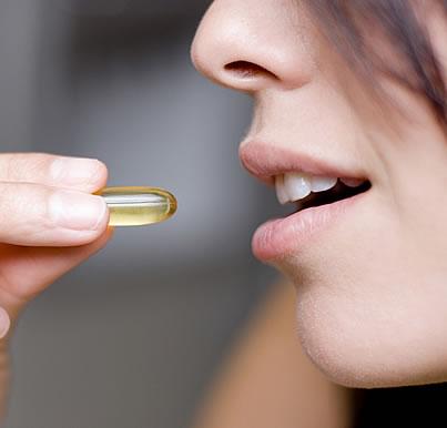 A girl taking Vitamin Supplement