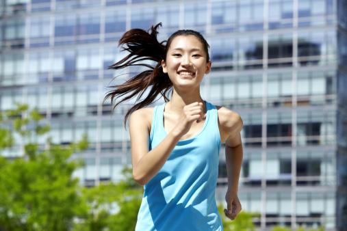 Smiling girl in running