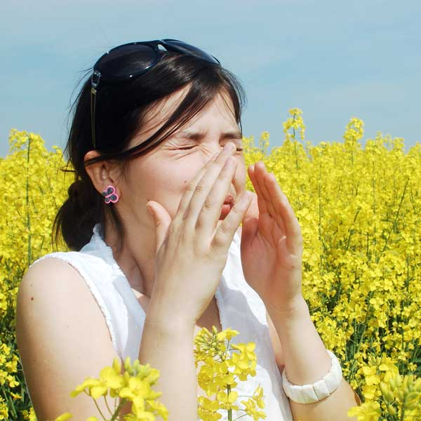 Women sneezing due to allergy