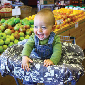 Baby smilling while shopping