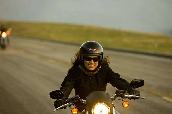 A girl riding a motorcycle
