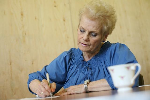 Woman Writing a Heartfelt Sympathy Card