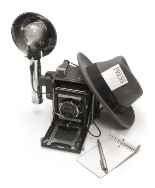 Journalist camera, hat with a press pass, and with notepad