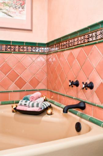 Pink and Green Tile Surrounding Bathtub