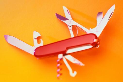 Penknife, orange background