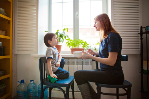 Mother And Son Sitting By Window