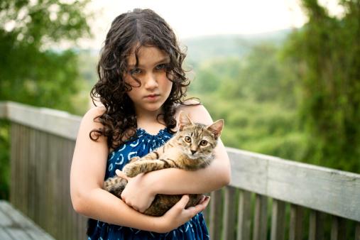 portrait of girl holding kitten