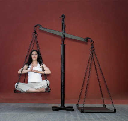 girl sitting in physical balance